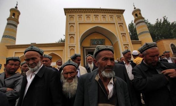 "The government has banned ""abnormal beards,"" viewing them as a sign of ""religious extremism."" Uighur Muslim men outside a mosque in Xinjiang region."